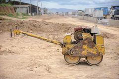 Vibrating roller. Little vibrating roller in construction site Stock Photography