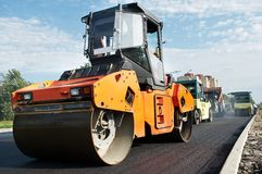 Vibration Compactor at asphalt. Group of compactors and Heavy Vibration rollers at asphalt pavement works (road repairing Stock Photo