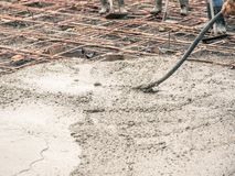 Vibration Machine for eliminate bubbles in concrete. after Pouring ready-mixed concrete. On steel reinforcement to make the road by mixing mobile the concrete stock photos