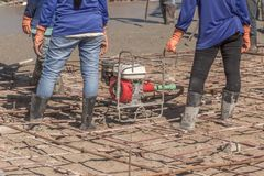 Vibration Machine for eliminate bubbles in concrete. after Pouring ready-mixed concrete. On steel reinforcement to make the road by mixing mobile the concrete royalty free stock image