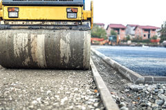 Vibration roller compactor at road construction and reparing asphalt pavement. compactor working Royalty Free Stock Photography