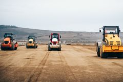 Vibratory Compactor during road and highway construction. Industrial roadworks with heavy-duty machinery Stock Photography