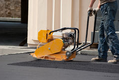 Vibratory plate compactor Stock Images