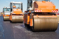 Vibratory rollers machines during road works Stock Photos