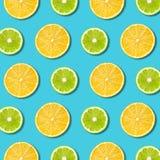 Vibrerande citron och grön limefruktskivatextur på turkosbakgrund royaltyfria foton