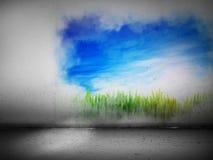 Vibrerande landskapmålning på en grå betongvägg Arkivfoto