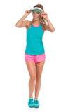 Vibrerande le kvinna i sportkläder royaltyfri bild