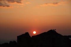 vibrerande röd solnedgång för färgliggande Arkivbild