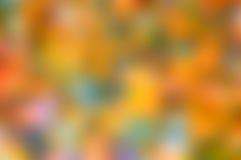 Vibrerande suddig bakgrund av orange och gröna färger för gräsplan, Arkivbilder