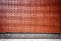 Vibrierende braune Backsteinmauer Lizenzfreie Stockfotos