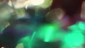 Vibrierender unscharfer heller Partikelglanz auf schwarzem Hintergrund Festliche ?berg?nge, ?berlagertes Video stock video footage
