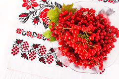 Viburnum on embroidered cross-stitch pattern. Top view Stock Image