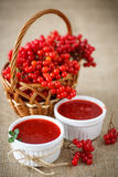 Viburnum jam. Guelder rose jam with fresh sweet viburnum on the table stock photo