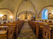 Interior of village church. VIBY, DENMARK -JANJURAY 08, 2018: Village church in front of the altar. It is a Gothic church built in the 1300s Royalty Free Stock Photos