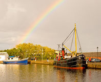 Vic 32 : boat and rainbow.  Stock Images