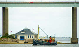 VIC 32 sailing past the Lifeboat House. Stock Photos