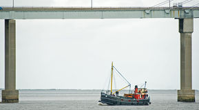 VIC 32 sailing under the Kessock Bridge. Royalty Free Stock Photos
