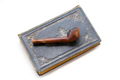 Vicars accessories vintage tobacco smoking pipe and holy bible Royalty Free Stock Photography