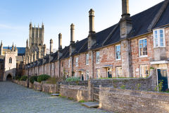 Vicars Close and Wells Cathedral Somerset, England. Vicars Close next to Wells Cathedral Somerset, England dating from the 15th century. With Wells cathedral in Stock Photo