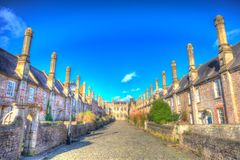 Vicars Close by Wells Cathedral Somerset England uk in colourful hdr. Vicars Close next to Wells Cathedral Somerset England uk historic row of cottages, houses Royalty Free Stock Images