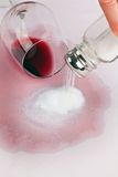 Vice empty glass of red wine. Salt. Royalty Free Stock Image