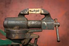 Vice tool with the word budget. Vice tool squeezing the word budget Stock Photography