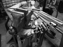 Vice and tools. Black and white image of a metalworker workshop, a vice and other tools royalty free stock images