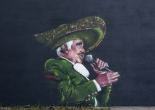 Vicente Fernandez mural by Ponchavelli, Dallas, Texas. Pictured is a mural by Ponchavelli featuring Vicente Fernandez, on the wall of Maxi Tax Services on Fort Royalty Free Stock Image