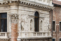 Vicenza, Italy. An old houses with statues against the walls in Vicenza, Italy stock photo