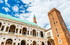 Vicenza, Italy: View of `Palazzo della Ragione` and blue sky with clouds. Vicenza - August 2017, Italy: View of `Palazzo della Ragione` and blue sky with clouds Stock Photos
