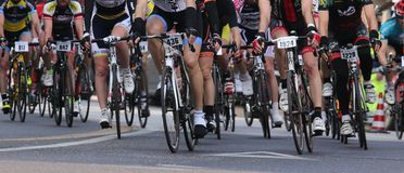 VICENZA, VI, ITALY - april 12 2015 cyclists run fast on racing bikes during cycle road race called GranFondoLiotto in Vicenza city. In Northern Italy in Vicenza Royalty Free Stock Photos