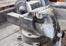 Vices on the bench. Ordinary vise. Equipment in the workshop stock photography