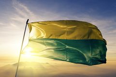 Vichada Department of Colombia flag textile cloth fabric waving on the top sunrise mist fog. Beautiful stock photos