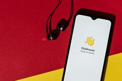 VICHUGA, RUSSIA - FEBRUARY 20, 2021: Logo of new trending app Clubhouse drop-in audio on smartphone screen and