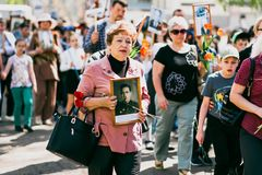 VICHUGA, RUSSIA - MAY 9, 2016: Immortal Regiment - people with portraits of their relatives, participants in the Second. VICHUGA, RUSSIA - MAY 9, 2015: Immortal Stock Photos