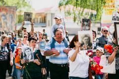 VICHUGA, RUSSIA - MAY 9, 2016: Immortal Regiment - people with portraits of their relatives, participants in the Second. VICHUGA, RUSSIA - MAY 9, 2015: Immortal Stock Image