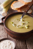 Vichyssoise soup in a bowl close-up on the table. vertical Stock Photo