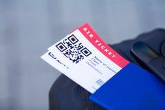 Vicino sul biglietto di aria due all'estero in passaporto vicino all'aeroporto immagini stock libere da diritti