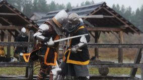 Vicious sword fight between two medieval warriors, martial arts competition. Stock footage stock footage