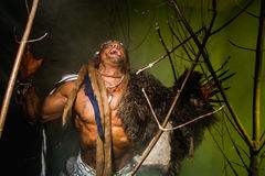 Vicious werewolf with a skin on his shoulder and long nails amon. G tree branches royalty free stock image