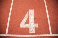 Vicolo della pista di atletica del fondo di struttura immagini stock libere da diritti