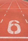 Vicolo numero sei della pista di atletica Fotografia Stock