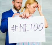Victim assault at workplace. Assault targeted at employee. Girl hold poster hashtag me too while colleague calm down her. Share assault story. Looking for stock photography