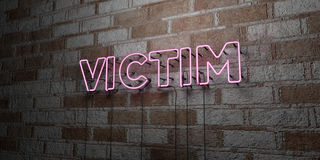 VICTIM - Glowing Neon Sign on stonework wall - 3D rendered royalty free stock illustration. Can be used for online banner ads and direct mailers Stock Images