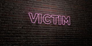 VICTIM -Realistic Neon Sign on Brick Wall background - 3D rendered royalty free stock image. Can be used for online banner ads and direct mailers Stock Image