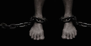 Victim, Slave, Prisoner male foor tied by big metal chain. Peopl Stock Images