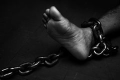 Victim, Slave, Prisoner male tied by big metal chain. Victim, Slave, Prisoner male foor tied by big metal chain. People have no freedom concept image Royalty Free Stock Images