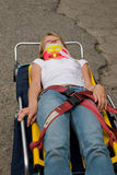 Victim on stretcher Stock Images