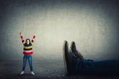 Victoire contre le patron photographie stock libre de droits