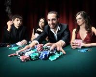 Victoires d'homme dans le casino Image stock